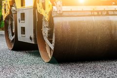 Background of asphalt roller that stack and press hot asphalt. Road repair machine.  Royalty Free Stock Photo