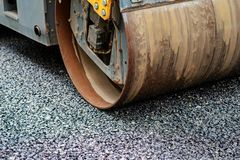 Background of asphalt roller that stack and press hot asphalt. Road repair machine.  Royalty Free Stock Image
