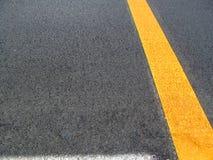 Background asphalt. On asphalt white and yellow stripes Royalty Free Stock Photos