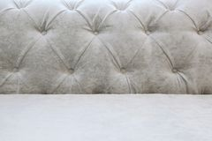 Background with a back and a seat of a light sofa - Carriage screed royalty free stock photos