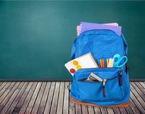 School bag on wooden table stock photos
