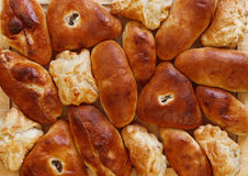 Background from the baked crisp pies. Of various form stock photography