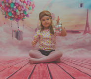 On the background balloon beautiful baby girl in a flight helmet Royalty Free Stock Photos