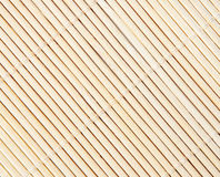 Background bamboo mat. Background of  bamboo mat of fine reeds close up Royalty Free Stock Images