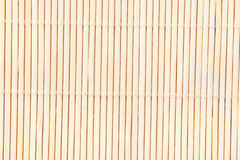 Background of  bamboo mat. Background of beige bamboo mat of fine reeds Stock Images