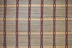 Background bamboo mat. Beige color with a pattern close up Royalty Free Stock Photography