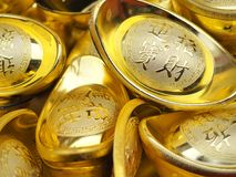 The words in Chinese new year`s gold bullions are mean ` Wish you have a flow of money.`. Background, banking, bullion, business, chinese, closeup, coin, coins stock photo