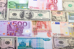Background from banknotes of various currencies Stock Images