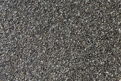 Background from basalt sand and stones - macro photo. royalty free stock photography