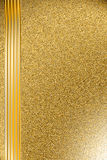 Background on the basis of the golden granulated surface. The blank for the cover of gold color Royalty Free Stock Image