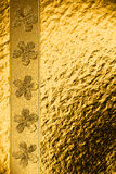Background on the basis of the golden granulated surface Stock Photo