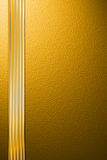 Background on the basis of the golden granulated surface. The blank for the cover of gold color Stock Photos