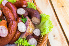 Background basket meat sausages meats Royalty Free Stock Images