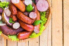 Background basket meat sausages meats Stock Photo