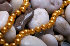 Background with beads. Water stones background with beads Royalty Free Stock Photography