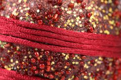 Background of beads and red threads. Royalty Free Stock Photos