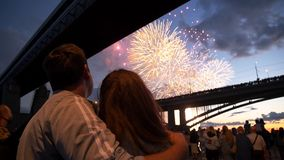 Background beautiful bright firework man and woman standing nearby enjoy show 4K. Background beautiful bright salute man and woman stand nearby enjoy show stock video