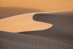 Background with sandy dunes in desert stock image