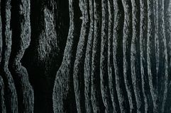 Background with a beautiful veined black wood. Dark Stock Images