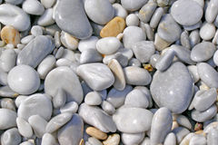 Background of beautiful, wet big pebbles on the beach. Background of beautiful, wet, big pebbles on the beach at the Lalaria Beach on the Skiathos Island Royalty Free Stock Photos