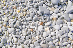 Background of beautiful, wet small pebbles on the beach. At the Lalaria Beach on the Skiathos Island Royalty Free Stock Photo