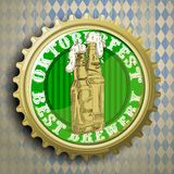 Background with beer cap. Cap for beer bottles on the background of the Bavarian ornament Stock Photography