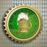 Background with beer cap. Cap for beer bottles on the background of the Bavarian ornament Stock Photo