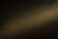 Background beige fabric highlighted by a spotlight. Royalty Free Stock Photography
