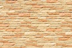 Background - beige stone facade decoration. Close-up stock image