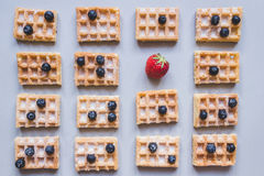 Background of belgian waffles with strawberry and blueberries on. The gray background Royalty Free Stock Photography