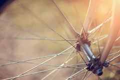 Background with a bicycle wheel with bokeh Royalty Free Stock Images