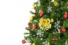 The background of a big green christmas tree decorated with lots royalty free stock photography