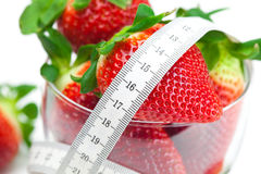 Background big juicy ripe strawberry and flower Stock Photos