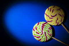 Background with big lolipops on blue Royalty Free Stock Photo