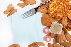 Background biscuits, waffles, fruit jelly and fork and napkin  Royalty Free Stock Images