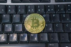 Background with bitcoin on the computer keyboard royalty free stock photo