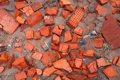 Pieces of broken bricks. Background of bits of broken brick lying on the ground Stock Photos