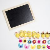 Background with black board with funny figures of chickens and flowers from felt. Easter card Royalty Free Stock Photography