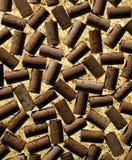 Wine bottle corks arranged on cork background. Close up of wine bottle corks arranged on cork background Stock Photo