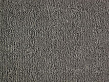 Background of black carpet or foot scraper or door mat texture Royalty Free Stock Images