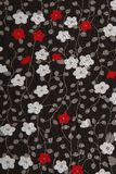 Background black fabric with red and white flowers Royalty Free Stock Images