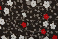 Background black fabric with red and white flowers Stock Image