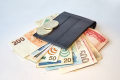 Background, black men`s wallet with bills of various currencies, isolated stock photo