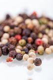 Background of black peppercorns Stock Photos