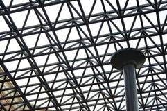 Background of black steel bars. Rejas de acero en primer plano y al fondo el cielo gris de una tormenta tropical stock image