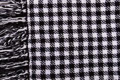 Background with black and white checkered scarf. Stock Images