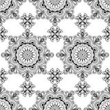 Background with black and white mehndi henna seamless lace buta decoration items on white background in Indian style. Royalty Free Stock Photography