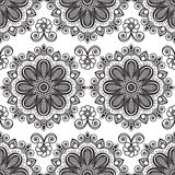 Background with black and white mehndi seamless lace buta decoration items on white background. Royalty Free Stock Photography
