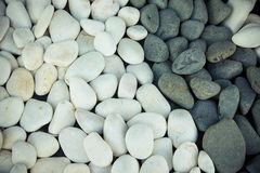 Background of black and white pebbles. Toned Stock Photo