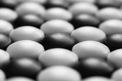 Background of black and white stones of Go game Royalty Free Stock Photography